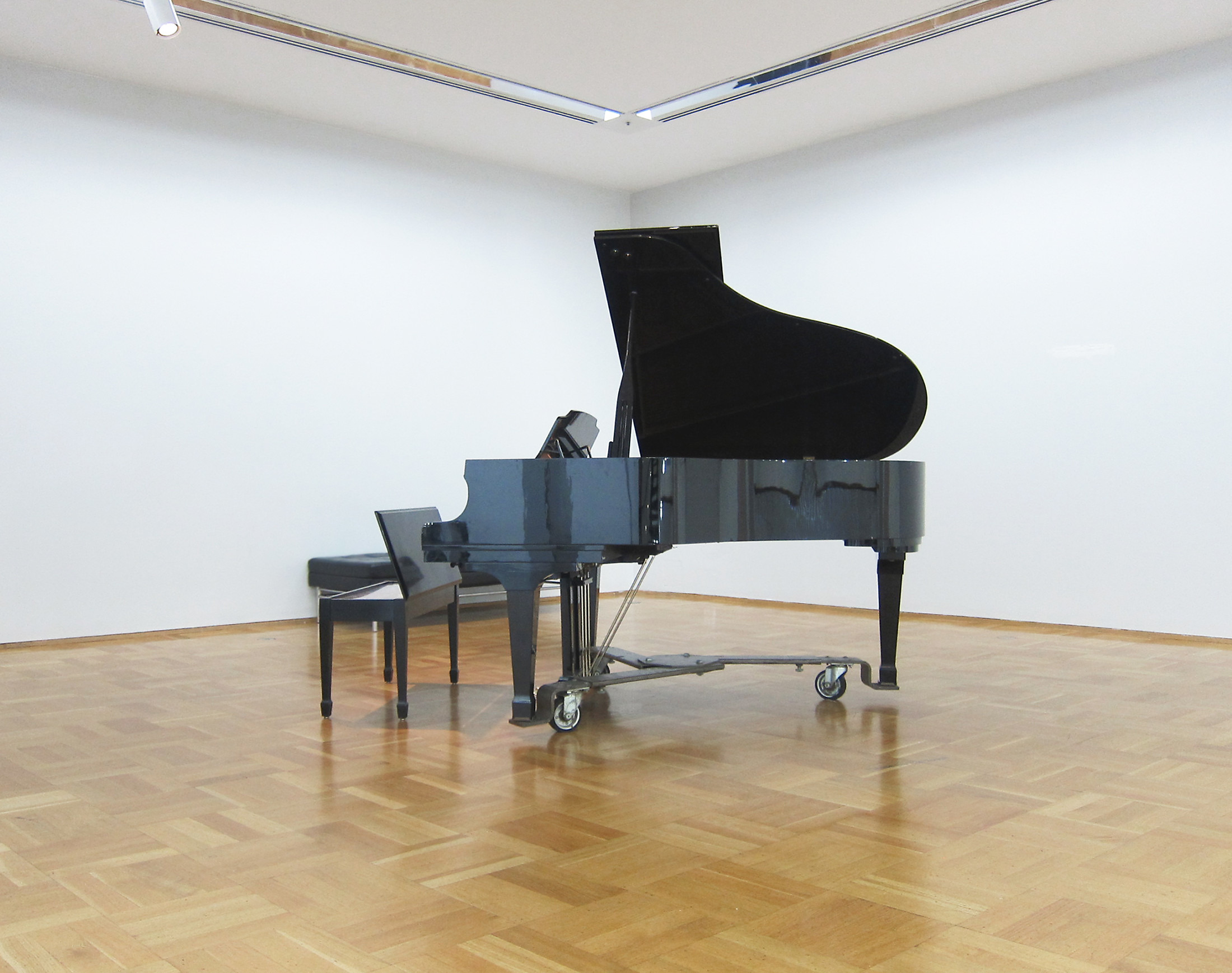 Untitled (3/19/13 – 6/18/13) Kawai grand piano, piano bench, sheet music, and student pianist, 2013 Part of Chicago Works: Jason Lazarus at the Museum of Contemporary Art, Chicago, IL