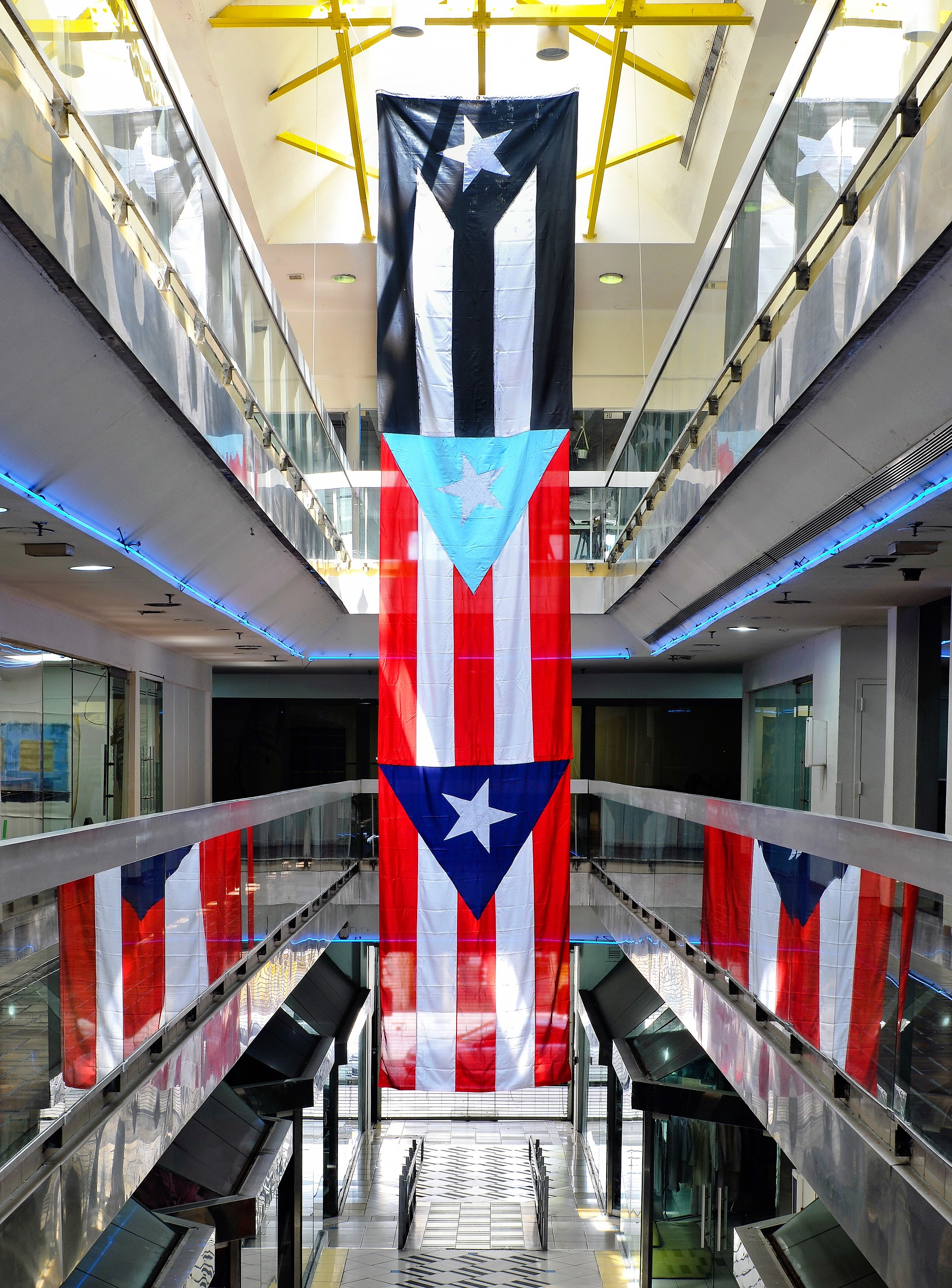 Banderas in Protest, a collaboration with Rafa Vargas Bernard Three traditional Puerto Rican flags, paint, rope 6×30′ 2018