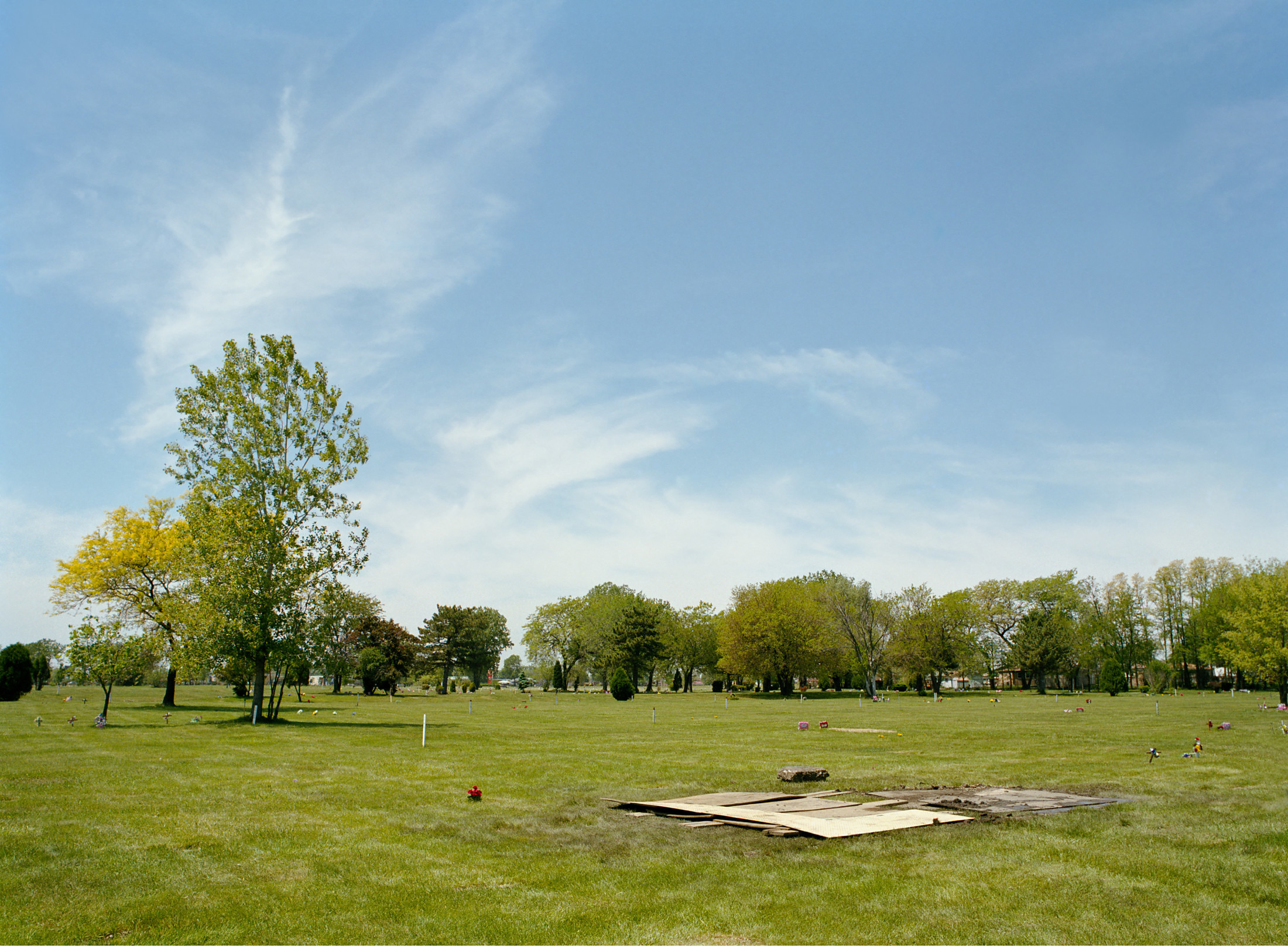 Standing at the grave of Emmett Till, day of exhumation, June 1st, 2005 (Alsip, IL) 43×56″ archival pigment print 2005