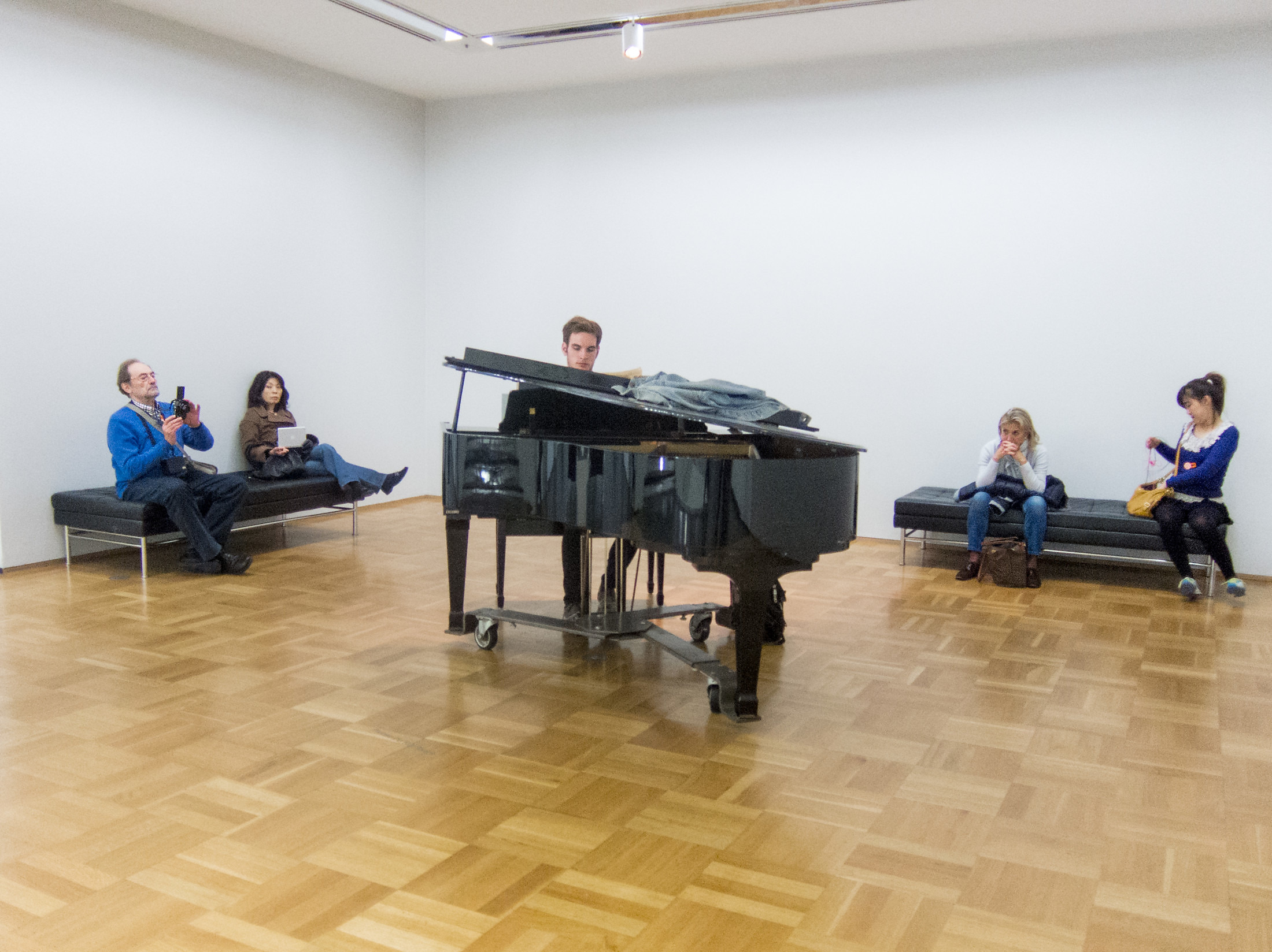 Untitled (3/19/13 – 6/18/13) Kawai grand piano, piano bench, sheet music, and student pianist, 2013 Part ofChicago Works: Jason Lazarus at the Museum of Contemporary Art, Chicago, IL